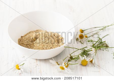 Recipes of traditional medicine camomile house. Immunity enhancement in alternative medicine. Recipes of the cosmetics with chamomile. An empty space to insert text.