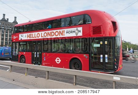 Westminster Bridge, London-September 6,2017: Public traffic red double decker bus on Westminster bridge on September 6, 2017 in London United Kingdom