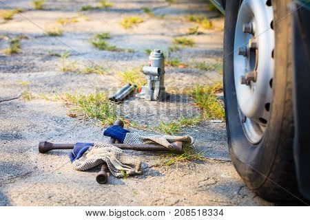 Socket Wheel Wrench And Jack Lying On Ground