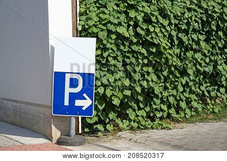 Parking road sign at the entrance of the parking lot