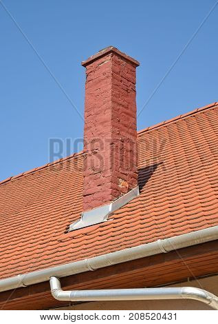 Roof of a house with smoke stack