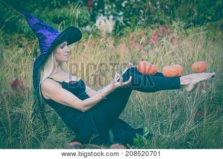 Active Girl In Witch Costume Practicing Yoga