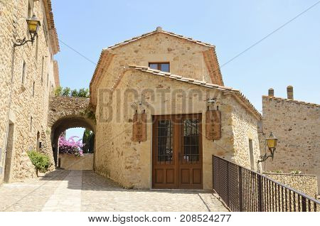 PALS, SPAIN - JULY 25, 2017: Exterior of studio in the medieval village of Pals located in the middle of the Emporda region of Girona Catalonia Spain.