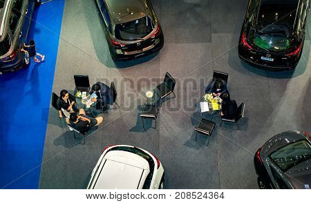 NONTHABURI THAILAND - OCTOBER 08: Customers sign contract and make payments at the Mazda dealership in CentralPlaza Westgate shipping mall in Nonthaburi on October 08 2017.