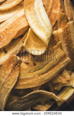 Stock Photo of Healthy Homemade Kela or Banana chips or wafers or Plantain Chips, selective focus