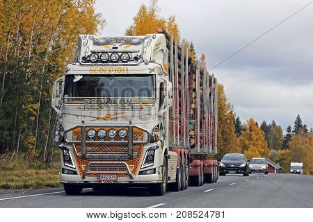 JOKIOINEN FINLAND - OCTOBER 6 2017: Customized Volvo FH logging truck Scorpion hauls timber along highway in autumn.