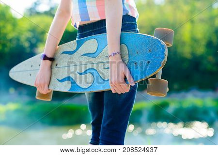 Young Skateboard Girl Holding Her Longboard Outdoors On Sunset