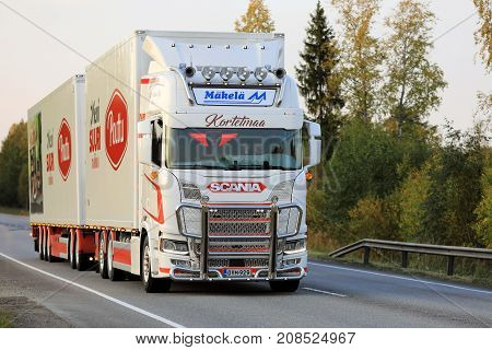 JYVASKYLA FINLAND - SEPTEMBER 23 2017: Customized Next Generation Scania R of Kortetmaa for temperature controlled transport hauls foodstuff along highway at sunset in Central Finland.