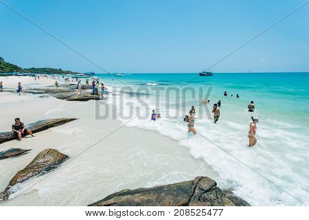 Rayong Thailand - March 16 2014 : tourists enjoying beach on March 16 2014 in Rayong Thailand.