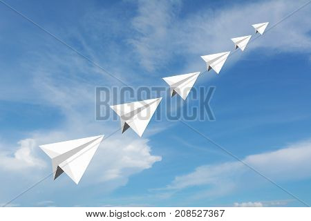 Paper airplane as a leader among another airplane leadership teamwork on blue sky background.