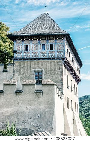 Detail photo of gothic castle Karlstejn in Czech republic. Ancient architecture. Travel destination. Blue photo filter.