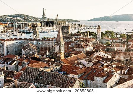 Trogir is a historic town and harbor on the Adriatic coast in Split-Dalmatia county Croatia. Travel destination. Architectural scene. Yellow photo filter.