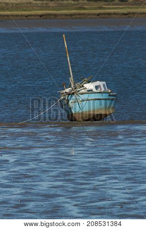 photo of a small boat on a sandbank