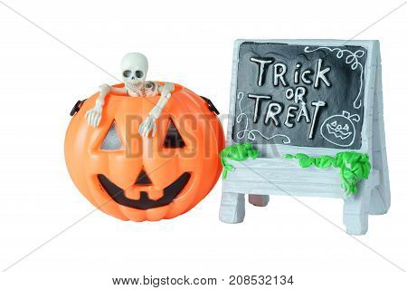 Halloween concept : Plastic human skeleton model inside plastic Halloween Pumpkin buckets and Trick or Treat sign isolated on white background