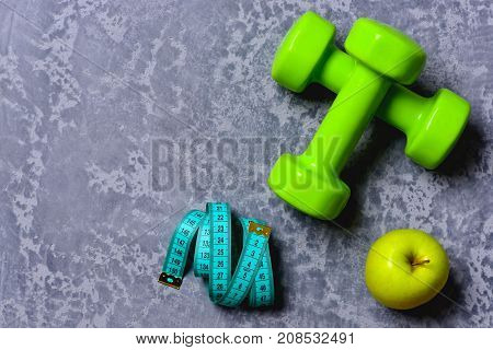 Sports And Training. Tape Measure And Fruit Near Barbell.