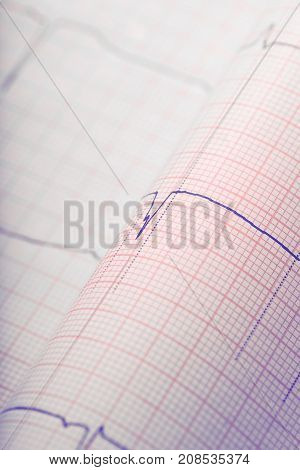 Cardiogram on the bended paper. Close-up photo