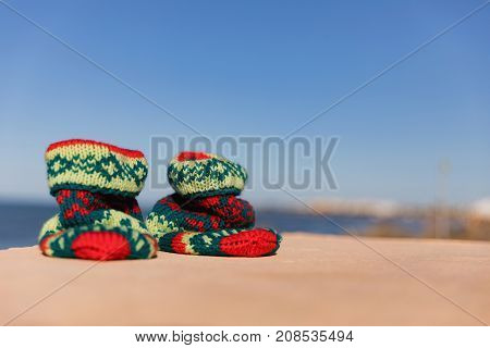 Christmas sock at exotic tropical beach. Holiday concept for New Years Cards. Christmas socks. hand-knit Christmas sock