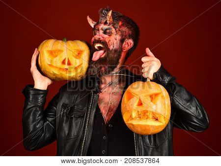 Devil Or Monster With October Decorations. Man Wearing Scary Makeup