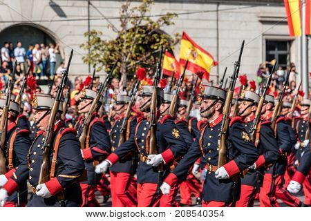 Madrid Spain - October 12 2017: Soldiers in traditional costume marching in Spanish National Day Army Parade. Several troops take part in the army parade for Spain's National Day.