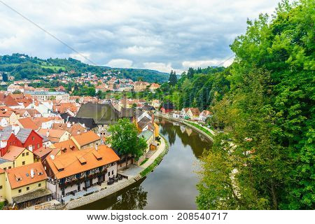 Castle Krumlov and Cesky Krumlov. Medieval fortress and the river Vltava. Red tile and narrow streets. Houses made of stone. The Rim of the River