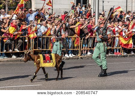 Madrid Spain - October 12 2017: Legionarios and goat marching in Spanish National Day Army Parade. Several troops take part in the army parade for Spain's National Day.