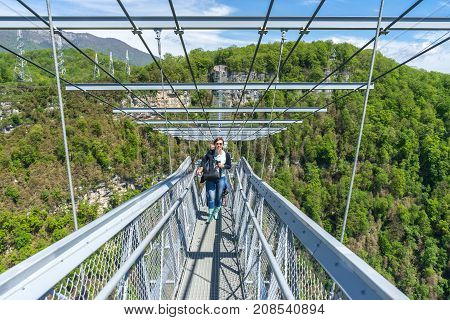 Russia Sochi - May 05 2015. Tourists on a suspension bridge in the Sochi sky park. This suspension bridge is the highest in Russia