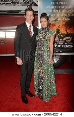 LOS ANGELES - OCT 8:  Miles Teller, Keleigh Sperry at the