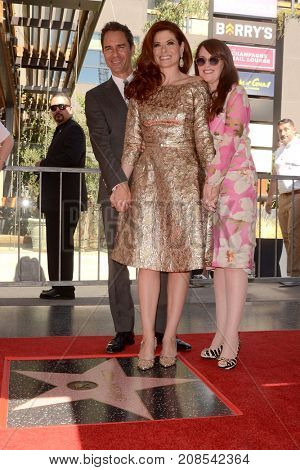 LOS ANGELES - OCT 6:  Eric McCormack, Debra Messing, Megan Mullally at the Debra Messing Star Ceremony at the Hollywood Walk of Fame on October 6, 2017 in Los Angeles, CA