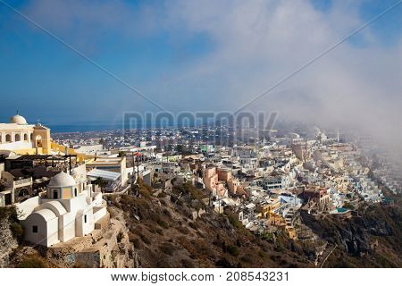 Village of Oia in Santorini Greece fog