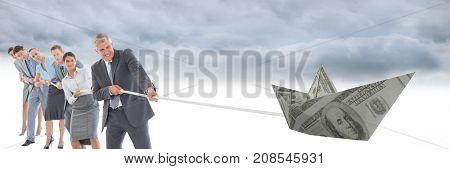 Digital composite of Business people pulling paper money dollar boat
