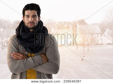 Digital composite of Man in Autumn with  with scarf and folded arms in housing estate