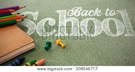 Back to school text against white background against pencils with thumbtacks and book