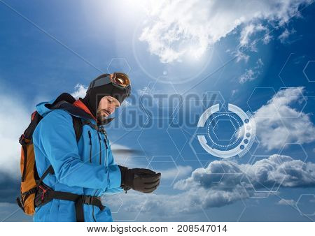 Digital composite of Explorer Man dressed in outdoors gear and clothes with cold sky interface
