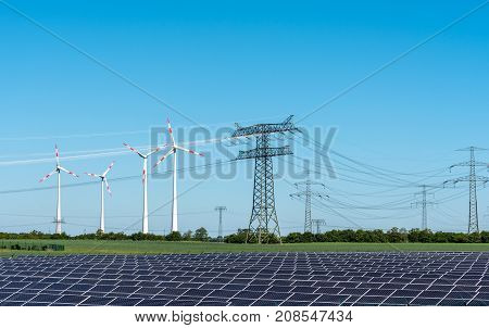 Solar energy panels, wind power and electricity pylons seen in Germany