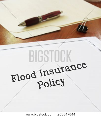 Flood Insurance Policy on an office desk