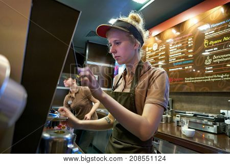 SAINT PETERSBURG, RUSSIA - CIRCA OCTOBER, 2017: worker at a McCafe coffee shop. McCafe is a coffee-house-style food and beverage chain, owned by McDonald's.