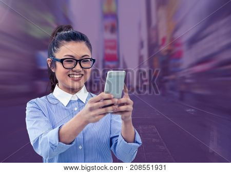 Digital composite of Woman holding phone in city