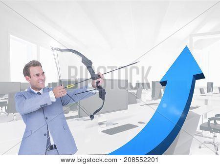 Digital composite of businessman with arrow