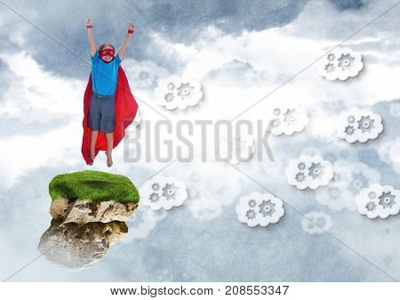 Digital composite of Young child superhero on floating rock platform  in sky with cog clouds graphics