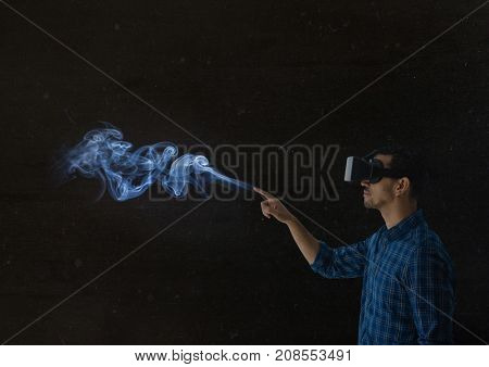 Digital composite of man using vr headset in dark place
