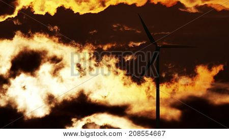Wind Turbine at sunrise. 3d rendering