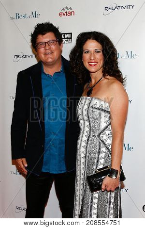 Songwriter Monty Powell (L) and Anna Wilson attend the screening of