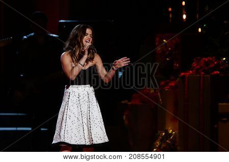 NASHVILLE, TN-NOV 7: Recording artist Lucy Hale performs at the 2014 CMA Country Christmas at the Bridgestone Arena on November 7, 2014 in Nashville, Tennessee.
