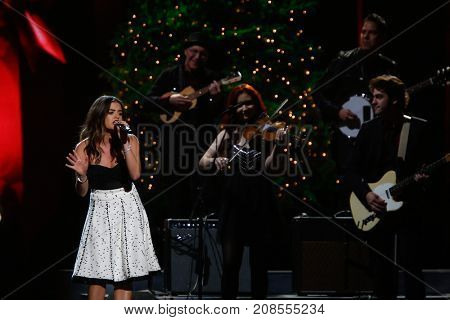 NASHVILLE, TN-NOV 7: Actress Lucy Hale performs at the 2014 CMA Country Christmas at the Bridgestone Arena on November 7, 2014 in Nashville, Tennessee.
