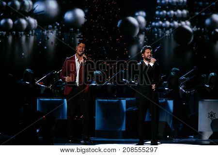 NASHVILLE, TN-NOV 7: Recording artists Dan Smyers (L) and Shay Mooney of Dan + Shay perform at the 2014 CMA Country Christmas at the Bridgestone Arena on November 7, 2014 in Nashville, Tennessee.
