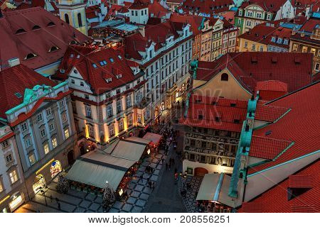 PRAGUE, CZECH REPUBLIC - DECEMBER 11, 2016: View from above on red roofs, shops and restaurants at Staromestske Namesti in Old town of Prague - capital of Czechia, fifth most visited city in Europe.