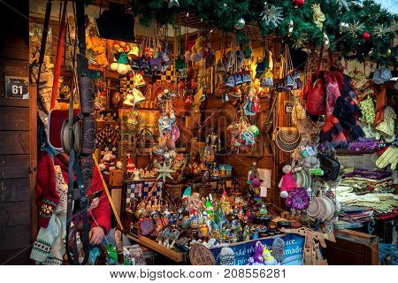 PRAGUE, CZECH REPUBLIC - DECEMBER 11, 2016: Wooden kiosks with souvenirs and decorations on Christmas market taking place each year in December. It is very popular place with tourists visiting Prague.