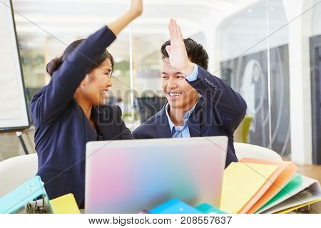 Business people congratulate each other with High Five for their start-up success