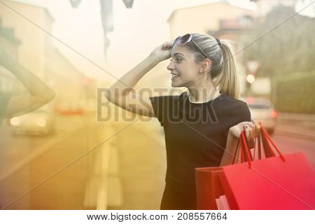 Shopping addicted carrying red bags