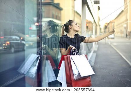 Shopping addicted making a selfie